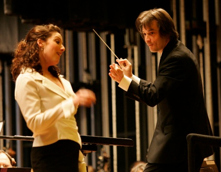 "Soprano Deborah Selig and Conductor Daniel Meyer during a piece from ""La boheme""."